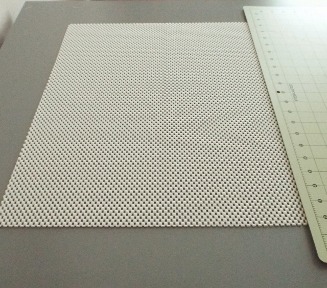 The kitchen mat I used to hold my cutting mat in place.