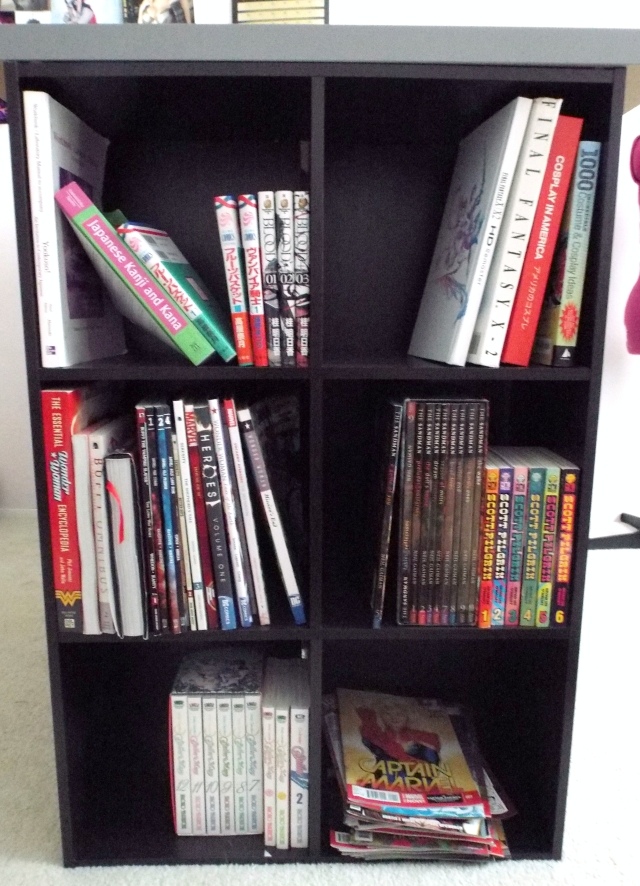The geeky/fun side. This holds most of my comics, trades, Japanese study materials, and manga!
