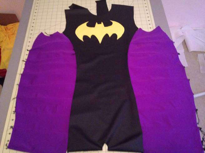 Batgirl! I opted for princess seams on Batgirl instead of the the straight up and down strip of purple she's drawn with. Curves are more flattering to those of us who live in 3D!